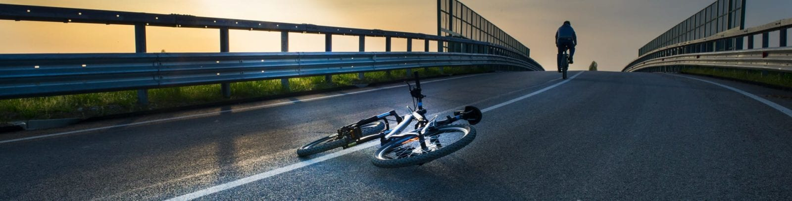Aftermath of Bicycle Accident On A Suburban Road Stock Photo