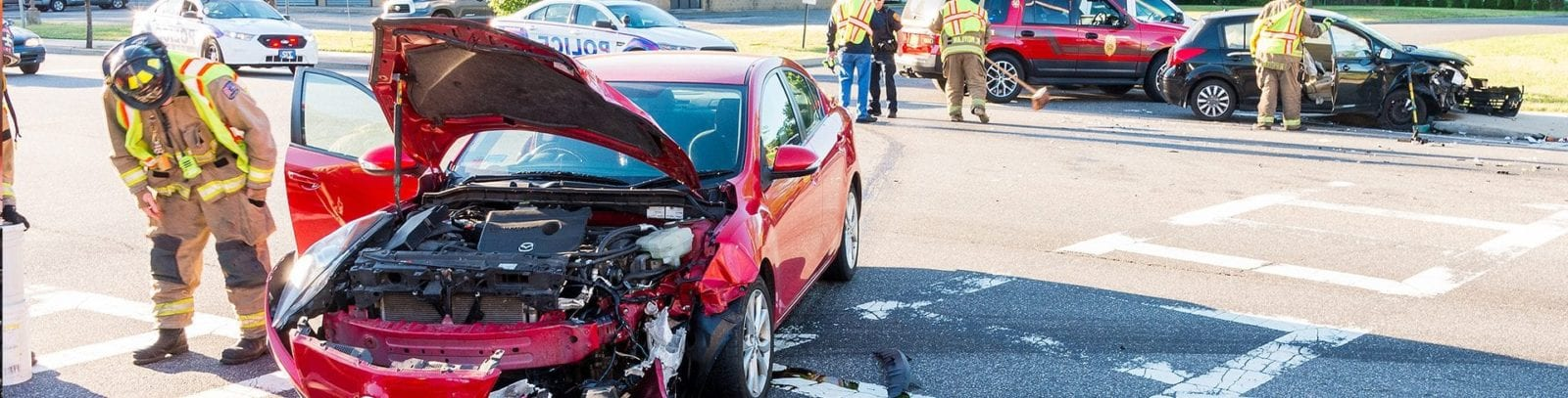 First Responders Addressing Car Accident Stock Photo