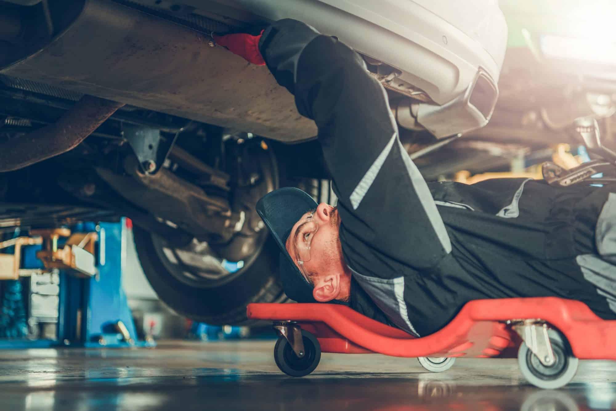 car-mechanic-under-the-car