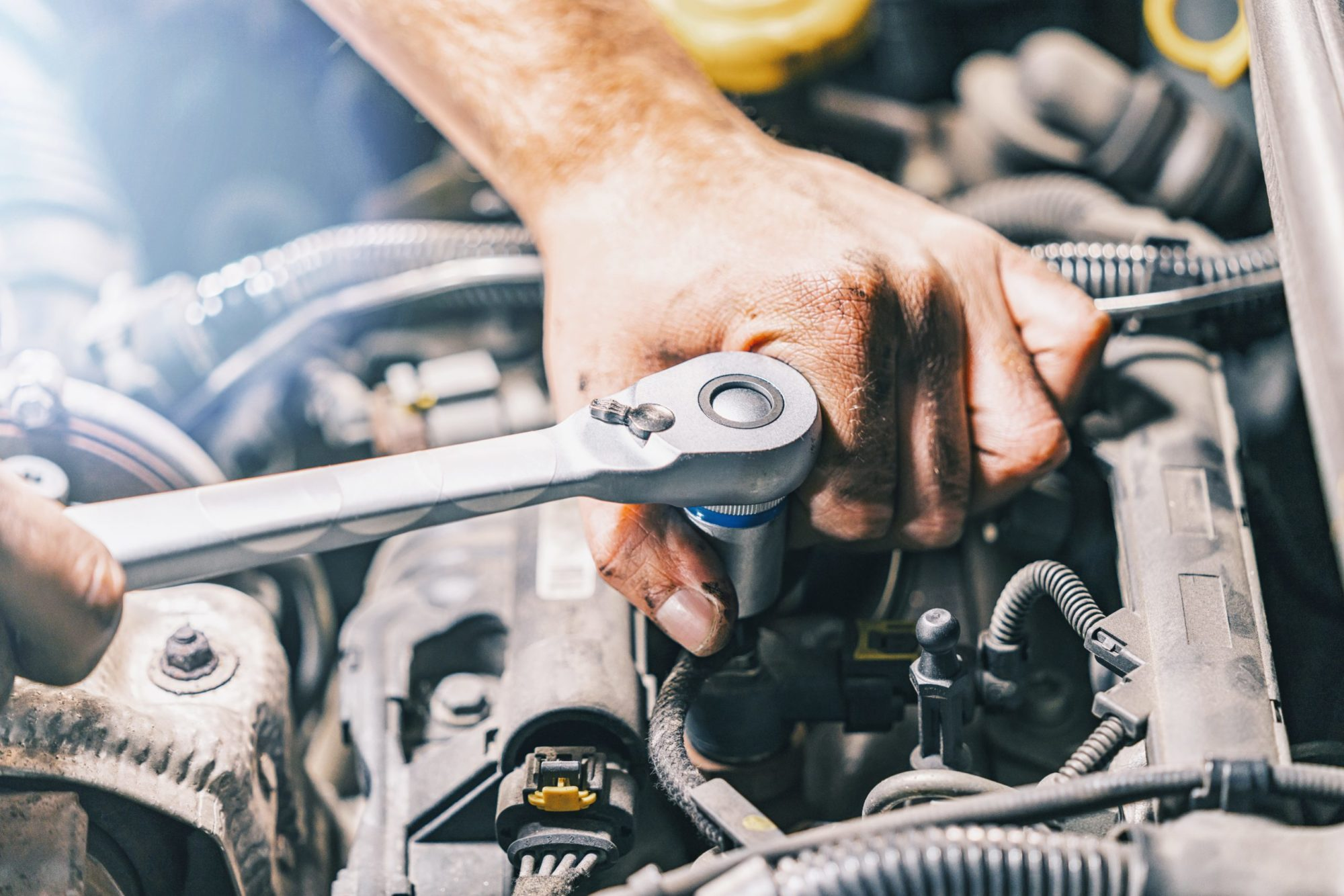 hands-of-car-mechanic