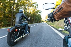 Motorcyclists Riding On Rural Road Stock Photo