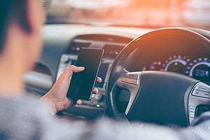 Male Driver Texting While Driving Stock Photo