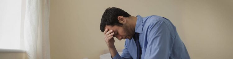 Young Man Grieving After Losing A Loved One Stock Photo