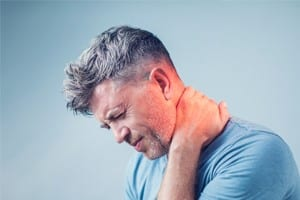 Middle-aged Man Experiencing Neck Pain Stock Photo