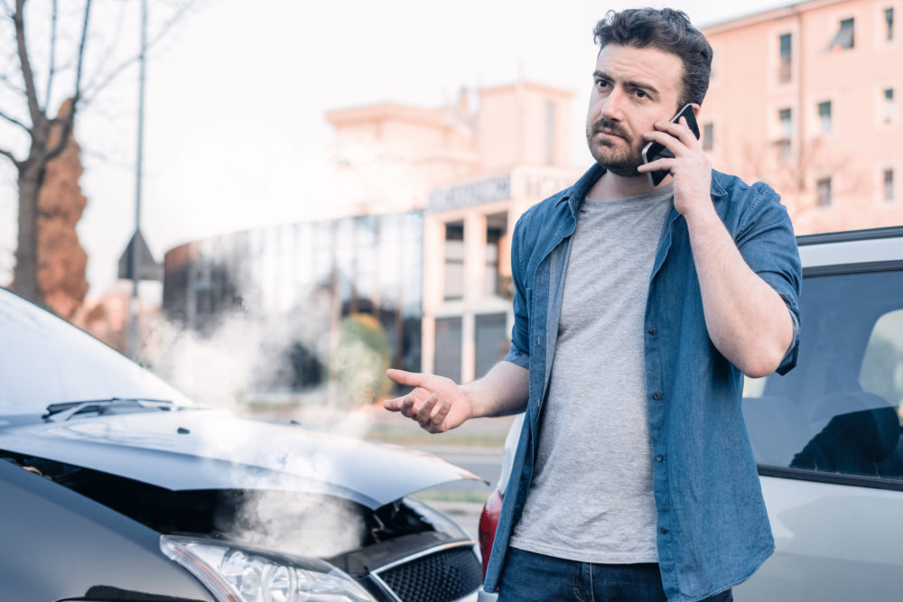 a man calling an attorney after a car accident in Montgomery, AL