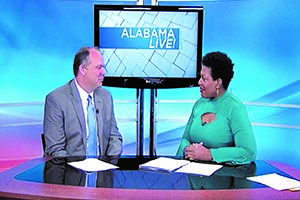 Jeff Hunter speaking with the host of Alabama Live for a TV segment.