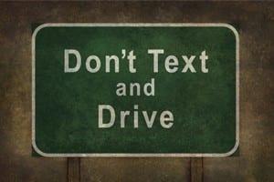 Don't Text and Drive Road Sign Stock Photo