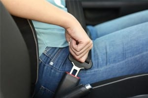 Woman Fastening Seat Belt Before Driving Stock Photo