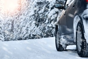 SUV Driving On A Snowy Rural Road Stock Photo