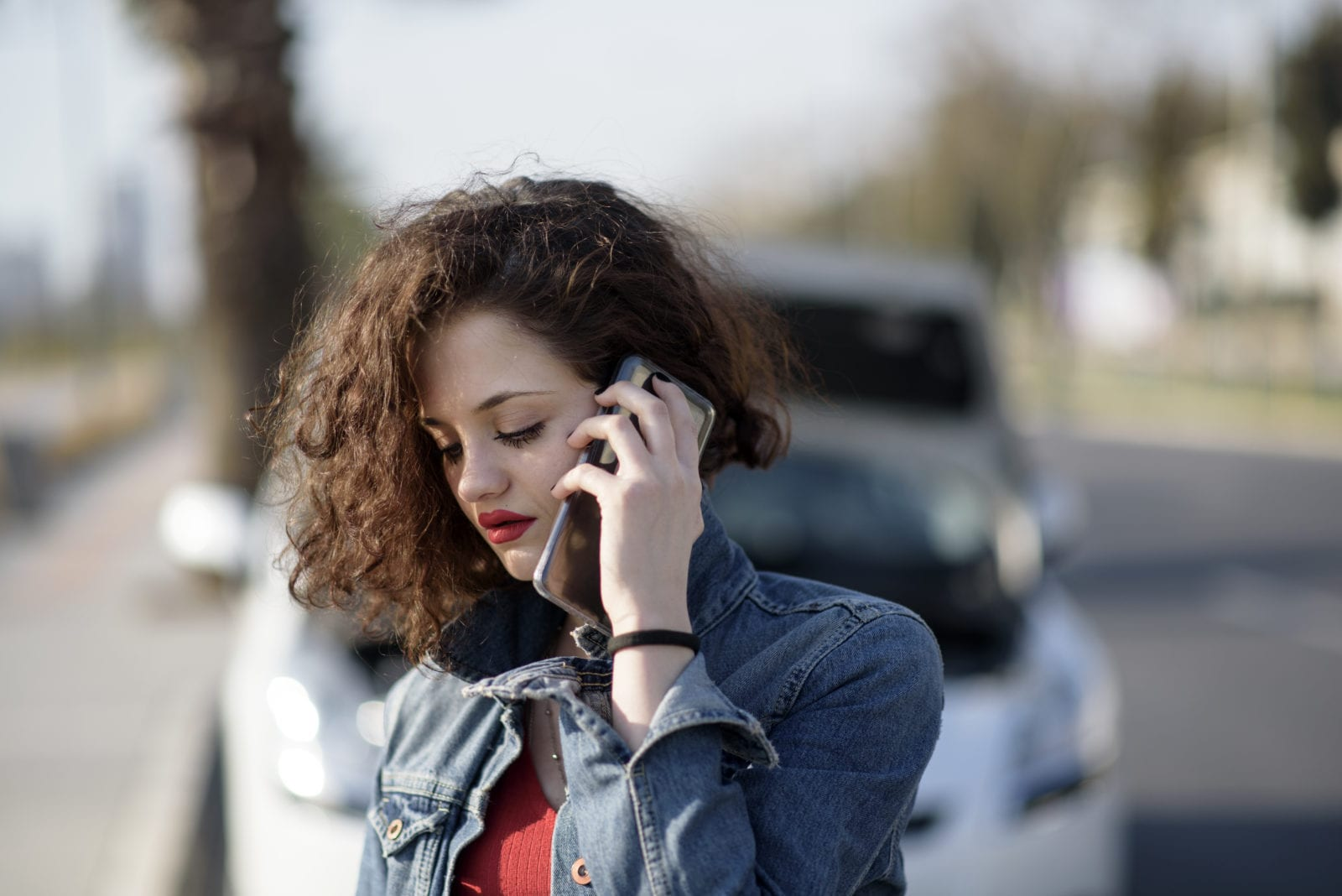 woman calling a lawyer after a car accident that wasn't her fault