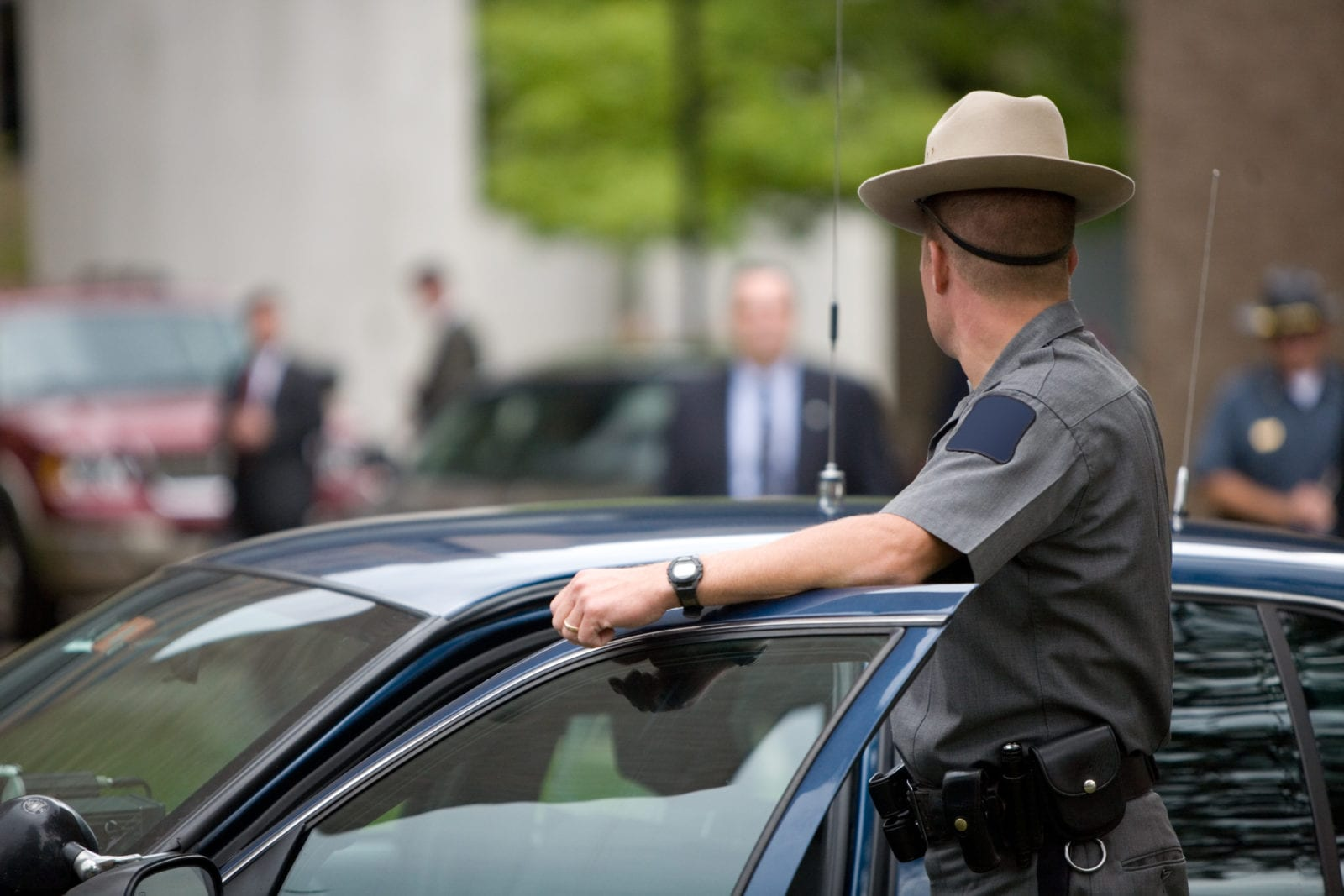 state trooper surveys area