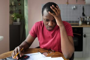 man worried about his medical bills after a car accident