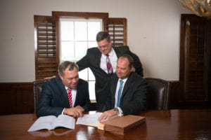The Floyd Hunter Injury Law team reviewing a case