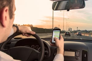 Young Man Texting While Driving In Car Stock Photo