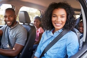 Family of Four Riding In A Minivan Stock Photo