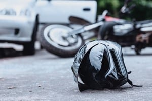 Motorcycle Helmet Laying On The Pavement Stock Photo